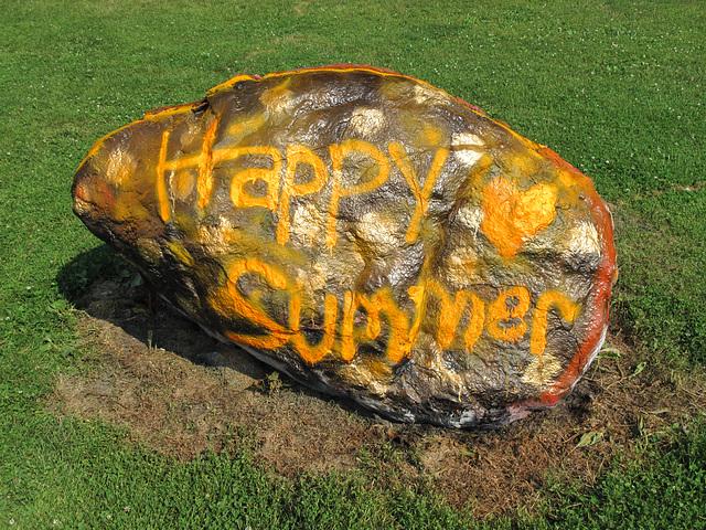 A public art boulder in a grade-school schoolyard.