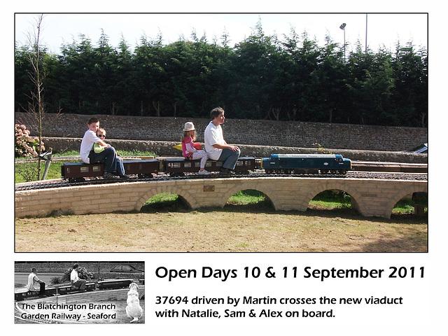 Blatchington Garden Railway 37694 with grandchildren on viaduct 10 9 2011