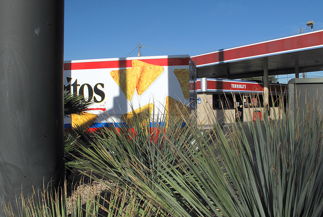 Deliverymen are out dropping off sacks of Doritos for resale at Terrible's Gas.