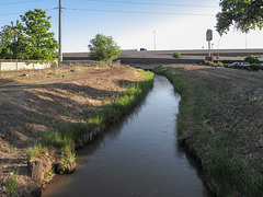 "Here come the waters in the stream known as the ""Alameda Drain.""  It just got finished flowing underneath of I-40!"