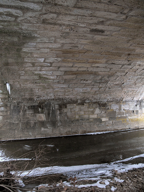 I will be safe under this old bridge, along this frozen creek.