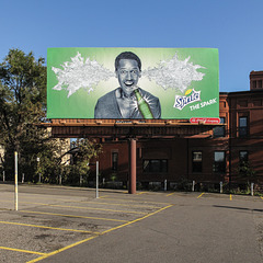In Minneapolis, the male model in a low-cut top gets Sprite blasting out of his ears.