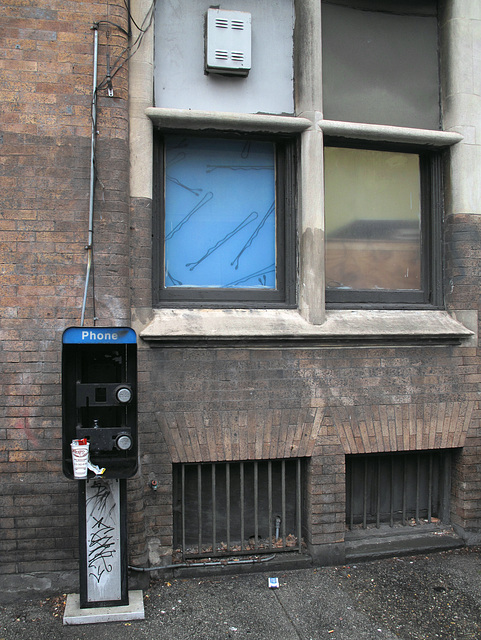 A nonphone; a bobbypins art panel in a window.