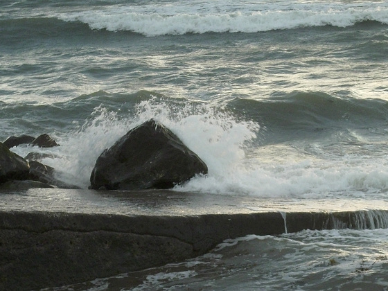The beauty of a wave crashing against a rock