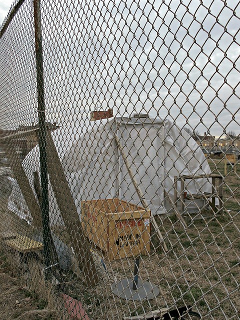 Small white quonset hut of tarpaulins in Washington DC.