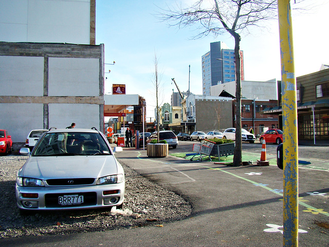 Cars parked where buildings once stood