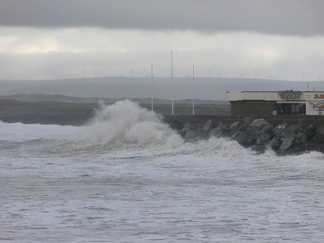 The sea wall is making the waves crash