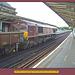 EWS 66063 passing west-bound through Peckham Rye Station -  8.7.2006