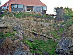 Abandoned house on cliff edge, Sumner