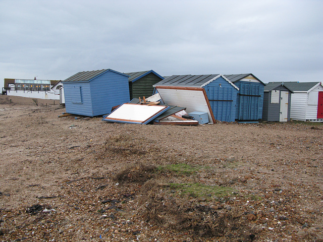 Smashed and dislodged huts near Inn on the Beach, Hayling Island