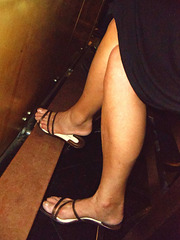under the table shot of my wife's legs