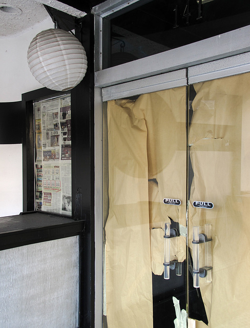 Shine a globular paper lantern onto these newspaper pages; these wrinkled sheets of kraftpaper; and these poly(methyl methacrylate) doorhandles.