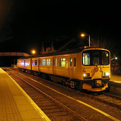 950001 in Strathcarron station at night
