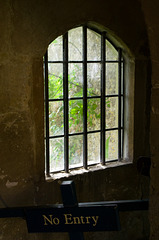 'No Entry' sign with gothic window at Lacock Abbey