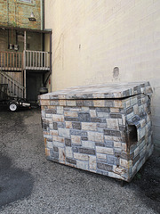 Camouflage dumpster.