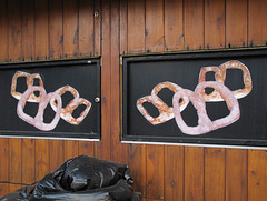 Old stickers of three pretzels and their mirror image.