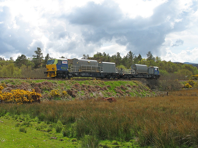 98907/98957 approach Plockton station with a weedkiller train