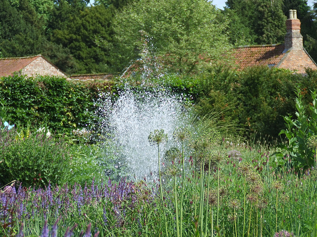 Fountain in flower garden
