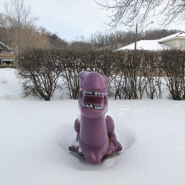 Smiling dinosaur ride.