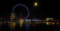 the london eye and a big moon