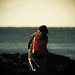 Woman By The Sea With A Red Bag