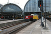 Railion 6498, 6499 and 6496 pulling a goods train through Amsterdam Central station