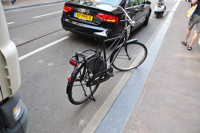Bicycle parked on the street in the Utrechtsestraat