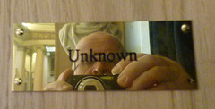 """Self portrait reflected in """"Unknown"""" brass plate, Playfair Library, University of Edinburgh Old College building"""