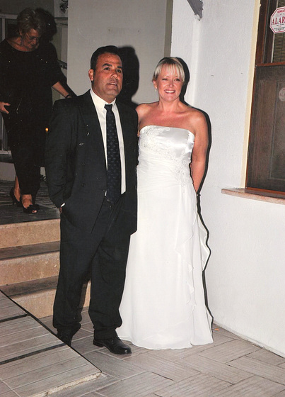 Mandi and Dogan looking classy at their wedding