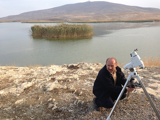 Shaho's uncle setting up the telescope