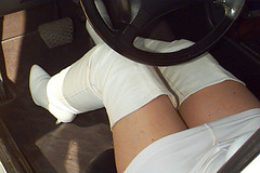 Carla !!!!!   The sexiest driver in white thighboots / Au volant en cuissardes blanches.