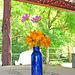 Flowers in a Blue Bottle