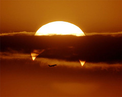 airplaine-crosses-partial-solar-eclipse