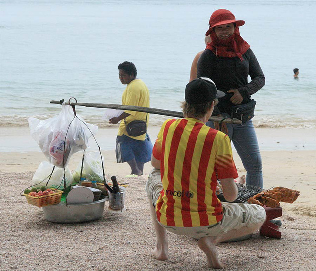 ordering lunch, fried chicken cooked on the beach