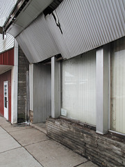 Wonderful aluminum surfaces on this interesting old building.  I loved this!