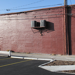 Brick-red wall.