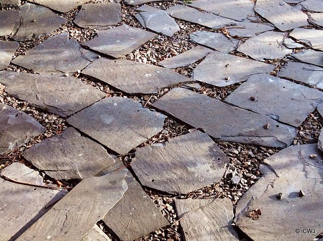 Old slates make good flooring in a garden gazebo