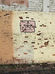 A wall mural of a smalltown school mascot.