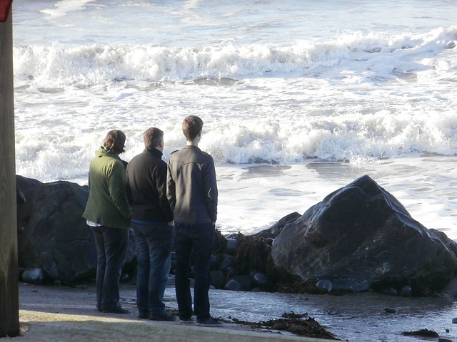 Some people admiring the waves