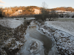 I'm tellin ya, dang, the sun's going down so fast, why, this icy creek is already in shadow, son.