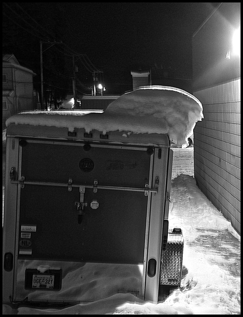 Snow on motorcycle trailer.
