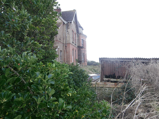 The back of the house which is right on the cliff edge
