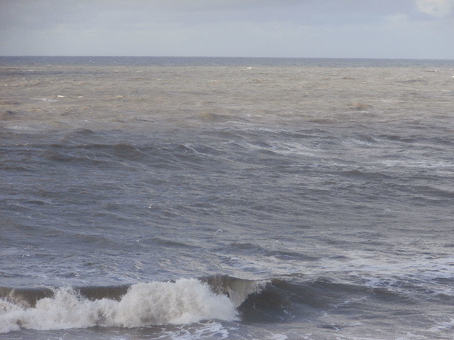 Just a slight sunny patch on the rolling grey sea