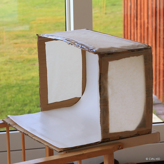 The Mk1 Lightbox: cardboard carton, three baking paper windows, and the back of an old calendar