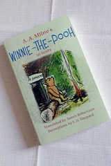 Lang lang syne, a lang while syne noo, aboot Friday past, Winnie-the-Pooh steyed in a forest aw by himsel unner the name o Sanders... :-)