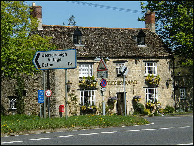 Greyhound pub with road signs