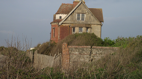 The old house is getting closer to the cliff's edge