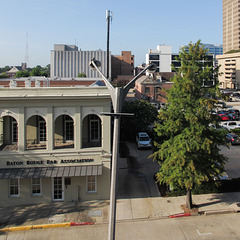 Clumsy arrangement of downtown Baton Rouge architecture with crooked two-headed lightpole.