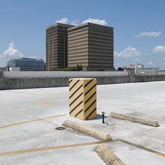 High, high atop this parking garage.