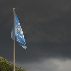 UN flag and stormy sky